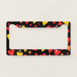 [ Thumbnail: Floating Red, Orange and Yellow Hearts Pattern License Plate Frame ]