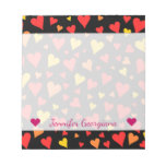 [ Thumbnail: Floating Red, Orange and Yellow Hearts Pattern Notepad ]
