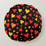 [ Thumbnail: Floating Red, Orange and Yellow Hearts Pattern Round Pillow ]