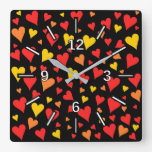 [ Thumbnail: Floating Red, Orange and Yellow Hearts Pattern Square Wall Clock ]