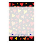 [ Thumbnail: Floating Red, Orange and Yellow Hearts Pattern Stationery ]
