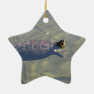 Floating turtle swimming in a pond ceramic ornament