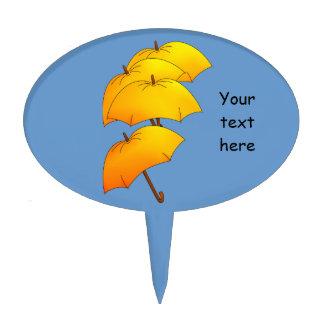 Floating yellow umbrella cake picks