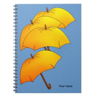 Floating yellow umbrella notebook