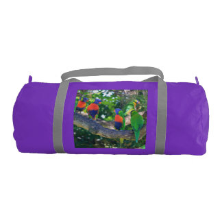 Flock of Rainbow lorikeets on a branch of a Tree Gym Duffle Bag