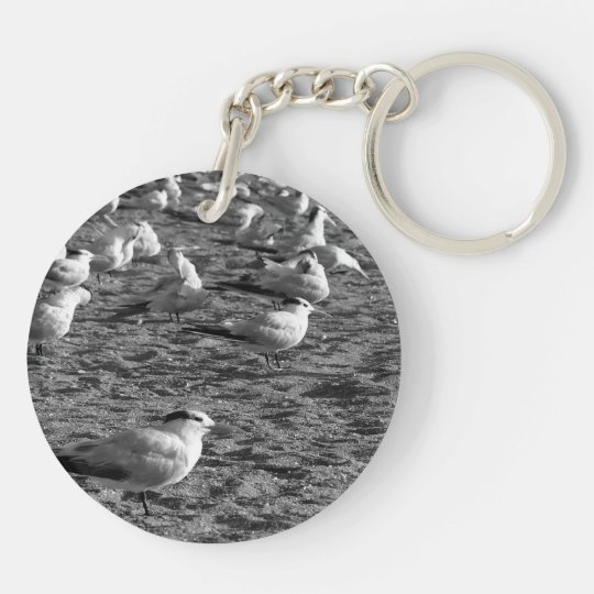 Flock of seagulls standing on florida beach keychain