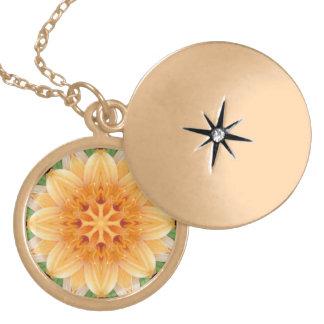Flor abstracta del caleidoscopio del naranja y del medallón