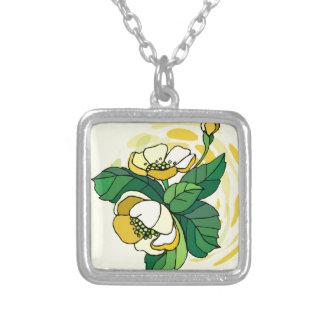 Flor amarilla con remolinos beige joyerías