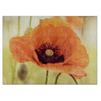 Flor anaranjada de la amapola tablas para cortar