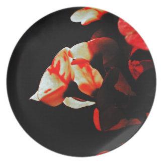 Flor anaranjada del cactus plato de cena