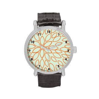 Flor anaranjada en verde salvia relojes de mano