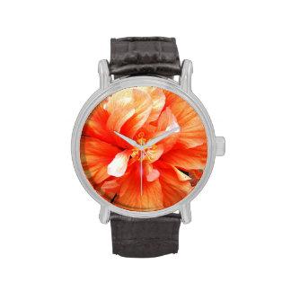 Flor anaranjada relojes