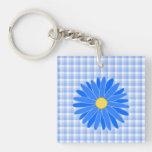 Flor azul brillante llaveros
