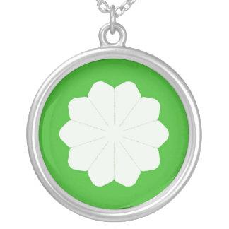Flor blanca en diseño abstracto verde colgante redondo
