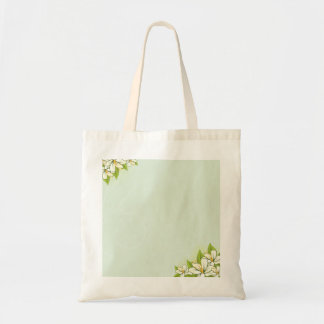Flor blanco lindo y hojas verdosas bolsas de mano