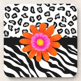 Flor cebra y de la piel y del naranja negros y posavaso