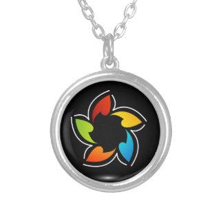 Flor coloreada arco iris grimpola
