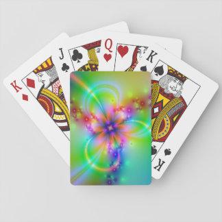 Flor colorida con las cintas cartas de póquer