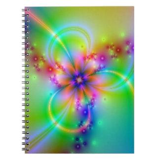 Flor colorida con las cintas libros de apuntes con espiral