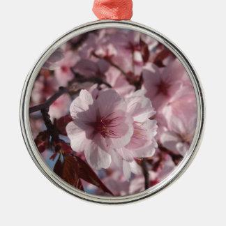 Flor de cerezo adorno navideño redondo de metal
