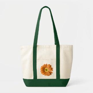 Flor de la margarita anaranjada bolsa tela impulso