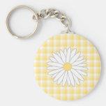 Flor de la margarita en amarillo y blanco llaveros