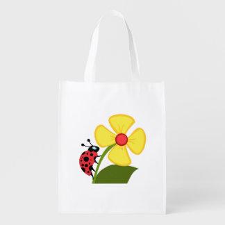 Flor de la mariquita bolsas para la compra