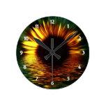 Flor de la puesta del sol reloj de pared