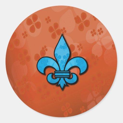 Flor de lis azul y anaranjada pegatina redonda