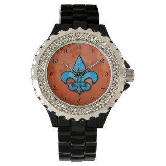 Flor de lis azul y anaranjada relojes de pulsera