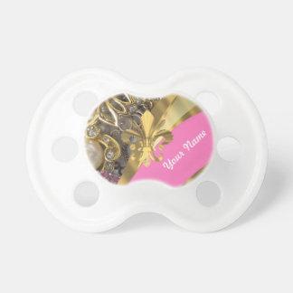 Flor de lis bling del oro chupetes para bebés