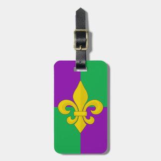 Flor de lis del oro del carnaval en púrpura y verd etiquetas de maletas