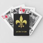 Flor de lis del oro en naipes negros baraja cartas de poker