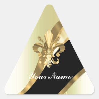 Flor de lis del oro personalizada pegatina triangular