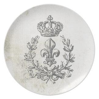 Flor de lis del vintage y placa de la corona platos