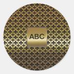 Flor de lis negra en el oro pegatina redonda
