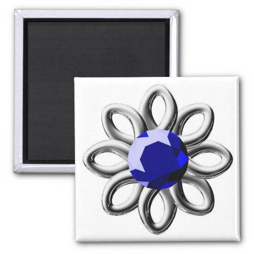 Flor de plata con la piedra azul iman