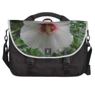 Flor del hibisco en la lluvia bolsas de portatil