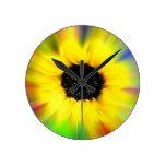 Flor del sol del arco iris relojes