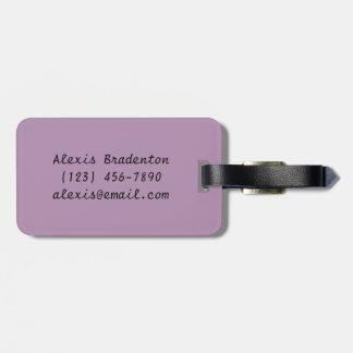 flor elegante elegante color de rosa violeta del etiqueta de maleta