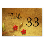 Flor en tarjeta de la tabla del fondo del oro