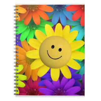 Flor feliz de la cara libros de apuntes con espiral
