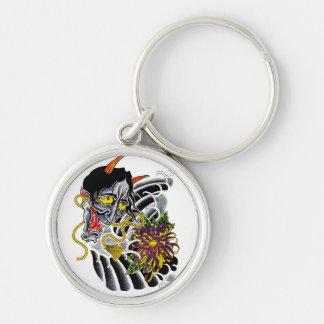 Flor japonesa del demonio del dibujo animado del s llavero redondo plateado