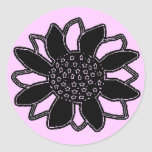 Flor negra etiqueta redonda