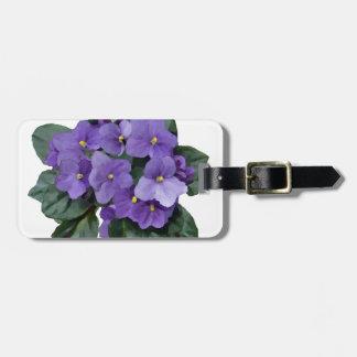 Flor púrpura del jardín de la violeta africana etiquetas para equipaje
