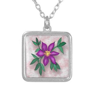 Flor púrpura en fondo texturizado rosa pendientes