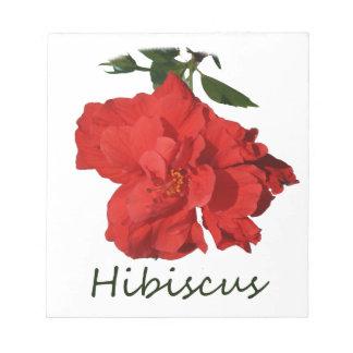 Flor roja del hibisco con el texto bloc