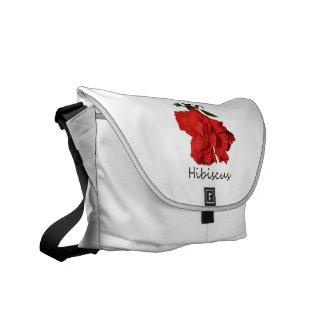 Flor roja del hibisco con el texto bolsas de mensajeria