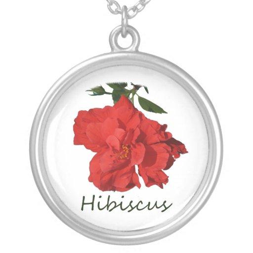 Flor roja del hibisco con el texto colgante redondo