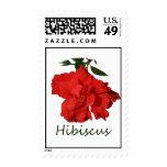 Flor roja del hibisco con el texto franqueo